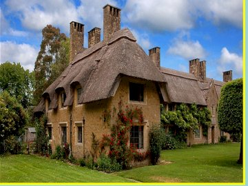 a cottage in the meadow - Thatched thatched cottage. A castle on top of a brick building.