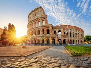 The Coliseum - . A large stone building.