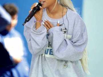 Ariana Grande - . Ariana Grande talking on a cell phone.