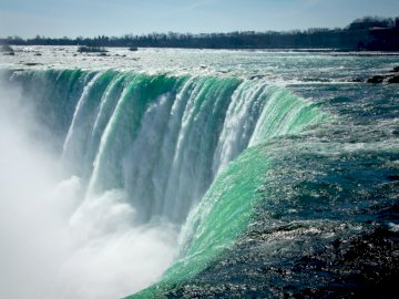 View - . A large waterfall over a body of water.
