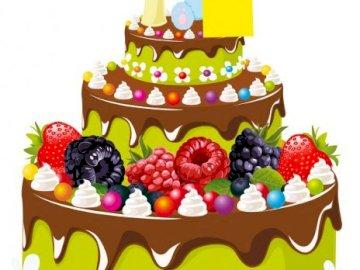 Tarta de cumpleaños - . Un pastel de cumpleaños con velas encendidas.