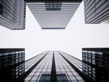 Office buildings under clouds - . A close up of a cage.
