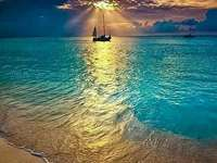 sail on ocean - . A body of water.