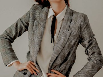 Boss Girl - Woman in gray blazer and white dress. Austria. A person wearing a suit and tie.