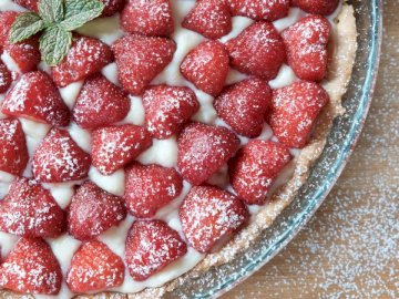 Homemade Strawberry Tart - Strawberries on clear glass bowl. Belgium. A bowl of fruit on a plate.