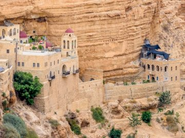 Israel - a monastery - -----------------------------------------------. A canyon with a building in the background.