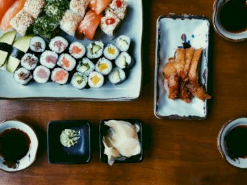 Sushi, food - Variety of cooked foods. A bunch of food on a table.