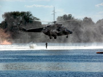cool plane airplane - nice plane that flies. A plane flying over a body of water.