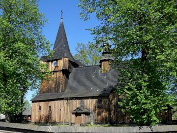 Sights of Wola Radziszowska - One of the monuments of Wola Radziszowska. A clock tower in front of a house with Urnes Stave Church