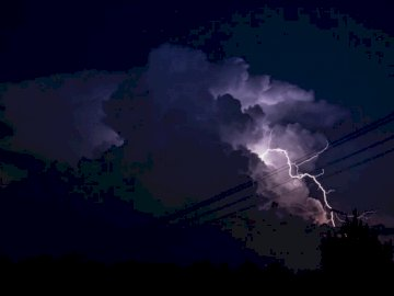 Isolated single cell - Lightning on skies. United States. Smoke coming from it.