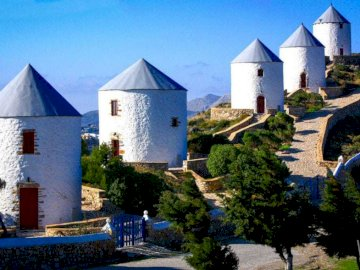 Leros Greece - Leros is a Greek island in the Dodecanese archipelago in the Aegean Sea. A castle on top of a house.