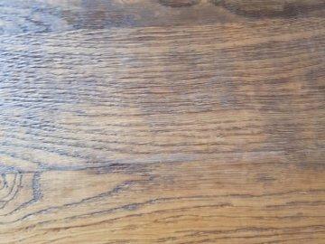 Juliusborus - Bild av trä sett uppifrån med linjer. En närbild av ett trägolv.