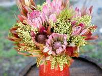 A wonderful bouquet - A bouquet of flowers as a gift. A pink flower on a plant.