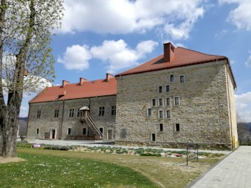 Sanok Castle - Royal Castle in Sanok. historical Museum. A castle on top of a brick building.
