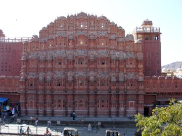 palace of winds in jaipur - the palace of winds in jaipur. A large brick building with many windows with Hawa Mahal in the backg