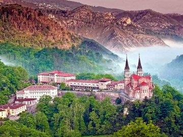 Real-sitio de Covadonga - Covadonga, Hispzania. Train with the top in the background.