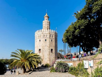 Torre del Oro - Torre del Oro de Sevilla. A large tall tower with a clock on the side of Torre del Oro.