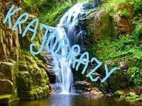 Assunto do curso Paisagens - Paisagens polonesas com o assunto da lição. Uma cachoeira com árvores ao fundo.