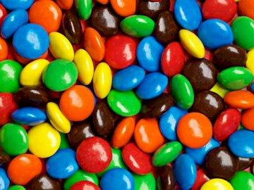 Bunte Süßigkeiten - Buntes Bonbonsortiment. Eine Gruppe bunter Luftballons. Bunt sortierte Bonbons. Eine Gruppe bunter L