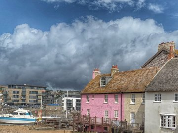 West Bay Harbor, - Pink concrete house. UK. A large building.