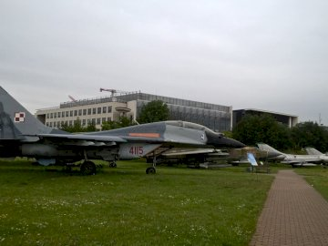 Mig-29 aircraft - Aviation Museum in Krakow. A fighter jet sitting on top of a grass covered field.