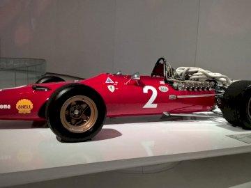 Ferrari F1 - Museum of Enzo Ferrari Modena. A red and white race car on display.