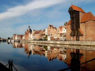 Gdansk panorama - on the Motława ---------------------------. A bridge over a body of water.