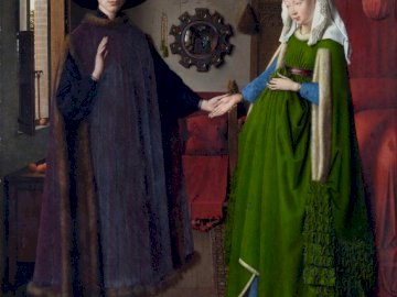 The Arnolfini Marriage (1434) - The Arnolfini Marriage by Jan van Eyck (1434). A person wearing a costume.