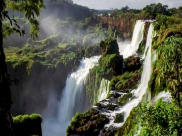 Waterfall . - Waterfall. Iguazu. Brazil. A waterfall surrounded by trees.