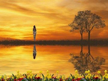 paysage magnifique avec une fille - paysage magnifique avec une fille. Un coucher de soleil sur un plan d'eau.