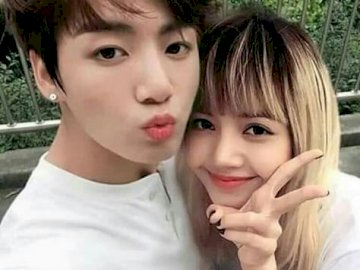 Lisa and JungaKook - tender jungkook and tender smooth. A little girl posing for a picture.