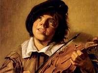 Un băiat care cântă la vioară