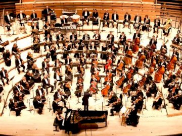 Orchestra - Champagne-Ardenne Symphony Orchestra. A group of people in front of a crowd.