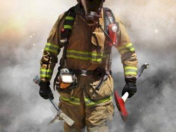 pompier - pompier en feu, Saint Florian patron des pompiers et sidérurgistes. Un homme monté sur un vélo su
