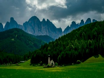 The best of South Tyrol / - Green grass field near green trees and mountain under cloudy sky during daytime. Germany. A large gr