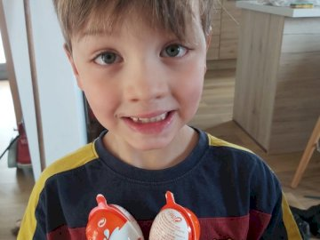 Laurence - Raphaël and his Easter eggs. A little boy that is eating some food.