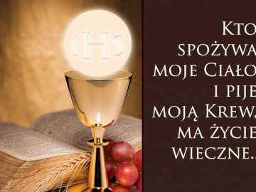 Eucharystia - Sakrament Eucharystii. Czarny znak z białym tekstem.