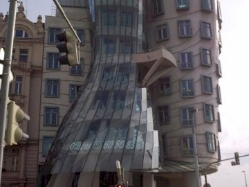 dancing house - dancing house in Prague. A group of people standing in front of Dancing House.