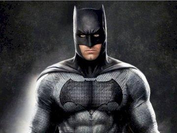 Groźny Batman - Batman postać z komiksów wydawnictwa DC. Osoba ubrana w kostium.