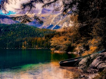 Italian landscape - lake - clouds - mountains. A small boat in a body of water.