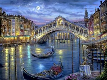 Puente de Venecia - Puente de Venecia por la noche. A river running through a city.