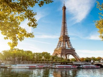 Eiffel Tower - France-Paris-Eiffel Tower. A large clock tower towering over a body of water.