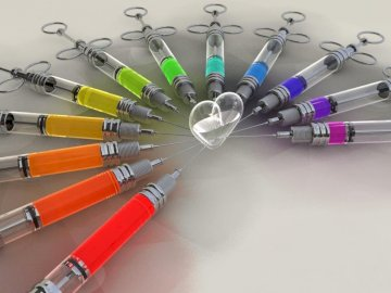 Colorful syringes - Colorful syringes. Do you like it ???. A group of items on a table.