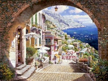 Positano. - Puzzle: view of Positano. A view of a stone building that has a bridge over a river.