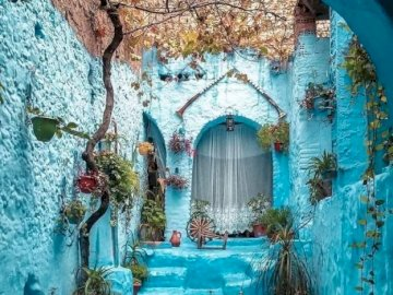 Chefchaouen, Morocco - Morocco, street, buildings. A building with a blue umbrella.