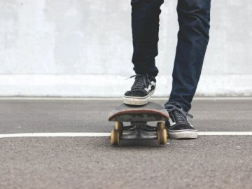 Vans & skateboard - Man riding skateboard. Indonesia.