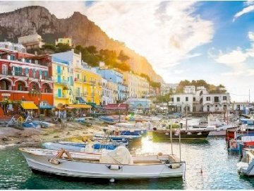 On the island of Capri. - Landscape on the Italian island of Capri. A small boat in a harbor.
