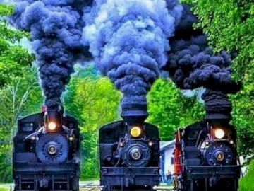 Locomotives. - Puzzle for children: steam locomotives. A toy train on a track with smoke coming out of it.