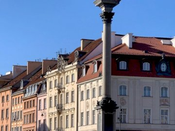 Warsaw - Castle Square and Sigismund's Column. A clock tower in front of a building.