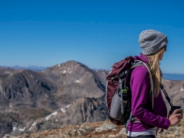 Backpacking across Europe - Woman hiking on mountain. Denver, Colorado. A person standing in front of a mountain.